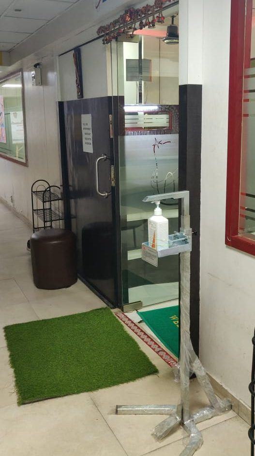 Sanitizer stand at entrance of clinic
